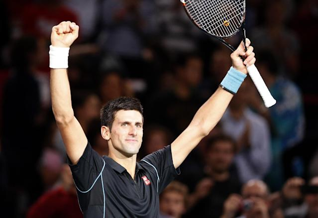 Novak Djokovic of Serbia reacts after defeating Roger Federer of Switzerland during their semi final match, at the Paris Masters tennis at Bercy Arena in Paris, France, Saturday, Nov. 2, 2013. (AP Photo/Francois Mori)