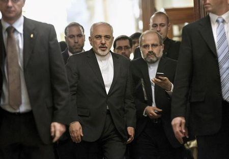 Zarif leaves a meeting at the Beau Rivage Palace Hotel in Lausanne