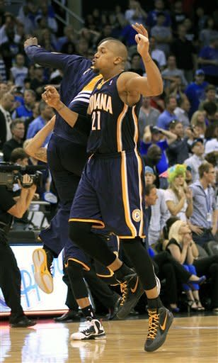 Indiana Pacers' David West jumps in the air after defeating the Orlando Magic 101-99 in overtime in Game 4 of an NBA first-round playoff basketball series, Saturday, May 5, 2012, in Orlando, Fla. (AP Photo/John Raoux)