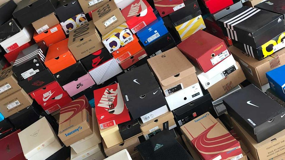 Dozens of shoe boxes piled on top of each other.