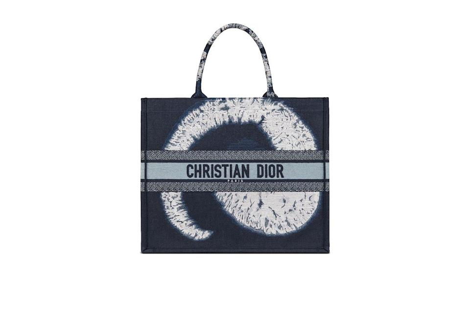 """<p>Take that whole tie-dye idea straight to the bag. </p><p><strong>Dior </strong>bag, $3,000, <a href=""""https://urldefense.com/v3/__https://www.dior.com/en_us/products/couture-M1286ZTYE_M886-dior-book-tote-blue-multicolor-tie-and-dior-embroidery__;!!Ivohdkk!yIR-R9h0E_eRr2MZduqrQ8h79D8gwdJTfiLkrzAP_AQodLo_Yo2Tx3hBne-h$"""" rel=""""nofollow noopener"""" target=""""_blank"""" data-ylk=""""slk:dior.com"""" class=""""link rapid-noclick-resp"""">dior.com</a> and Dior Boutiques Nationwide 1 800 929 Dior.<br></p>"""