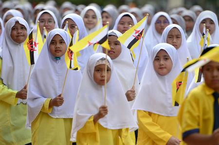 Students attend the 34th National Day celebrations in Bandar Seri Begawan, Brunei February 24, 2018. Picture taken February 24, 2018. REUTERS/Ahim Rani