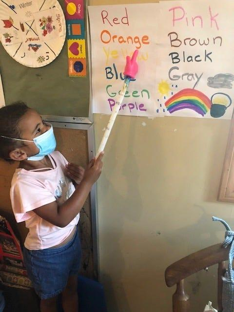 Aubrielle Sanchez reviews colors at Tender Times Child Care in Raynham, Massachusetts.