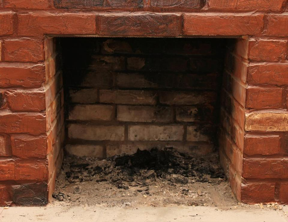 """Having an old-fashioned wood-burning fireplace provides a warmth and coziness to your home that the gas-powered equivalent just never seems to measure up to—but it also requires a far more involved cleaning regimen. And it's one you can't afford to ignore. The carbonaceous chemical """"creosote builds up every time you light a fire and the more fires you light, the thicker it gets,"""" Griffing says. Over time, this can lead to debris entering your home, and may even put you at risk for a chimney fire."""