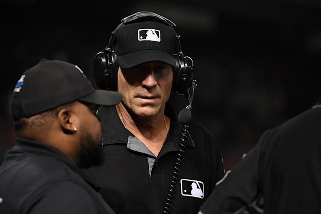 In a discrimination lawsuit, MLB claimed Angel Hernandez eavesdropped on an investigative phone call with another umpire. (Norm Hall/Getty Images)