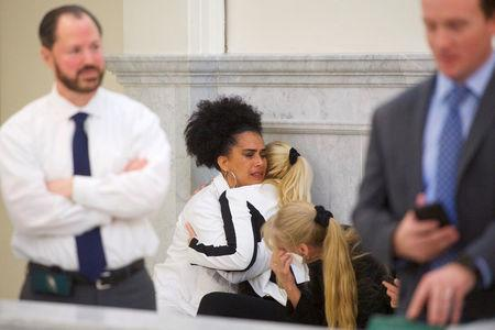 Bill Cosby accusers Lili Bernard and Caroline Heldman react after the guilty on all counts verdict was delivered in the sexual assault retrial at the Montgomery County Courthouse on April 26, 2018 in Norristown, Pennsylvania.   Mark Makela/Pool via REUTERS/Files