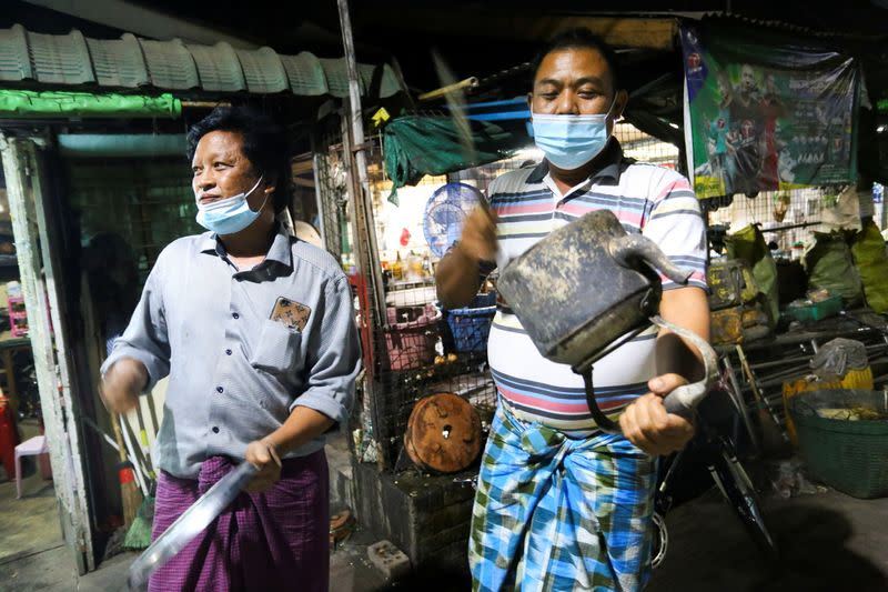 Local people bang pans the way they traditionally do it to drive away evil spirits, as they protest against military coup in Yangon