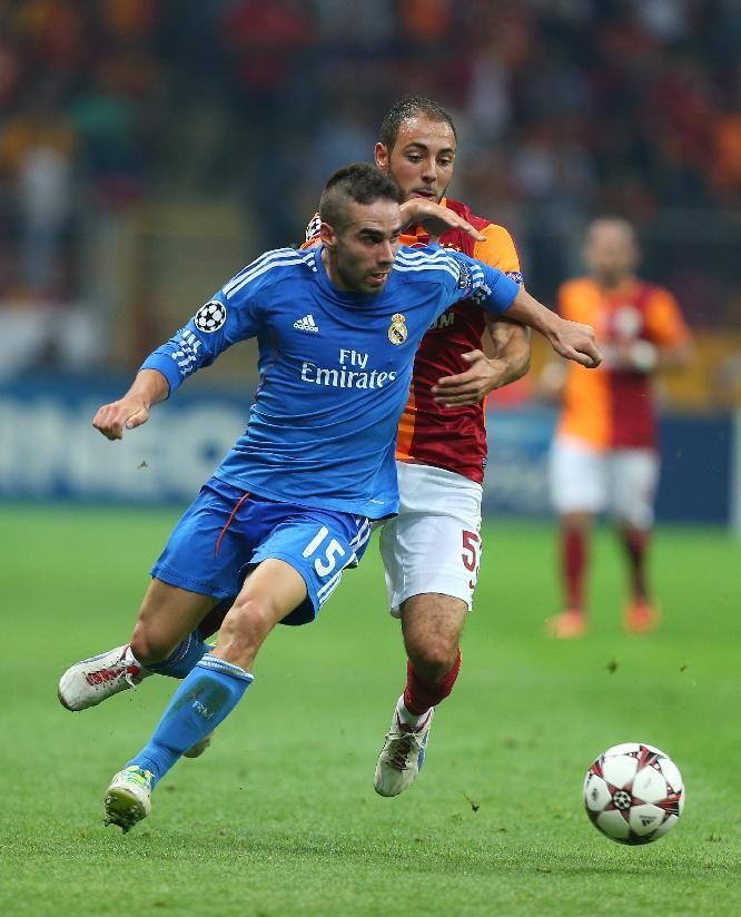 Amrabat of Galatasaray, background,  vies for the ball with Real Madrid's Daniel Carvajal, during their  Champions League Group B soccer match, in Istanbul, Turkey, Tuesday, Sept. 17, 2013. (AP Photo)