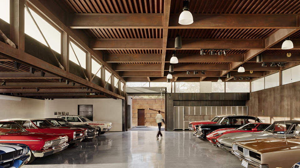 The stunning 10-car garage on the property with wooden fixtures. - Credit: Casey Dunn