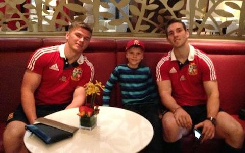 Alex Nicholson pictured with Lions rugby players Owen Farrell and George North - Credit: Facebook