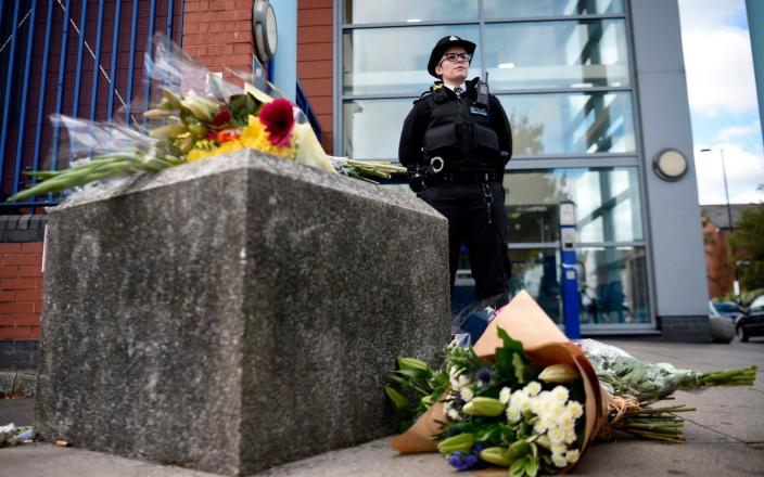 Floral tributes outside the Croydon Custody Centre where the officer was killed - DANIEL LEAL-OLIVAS/ AFP