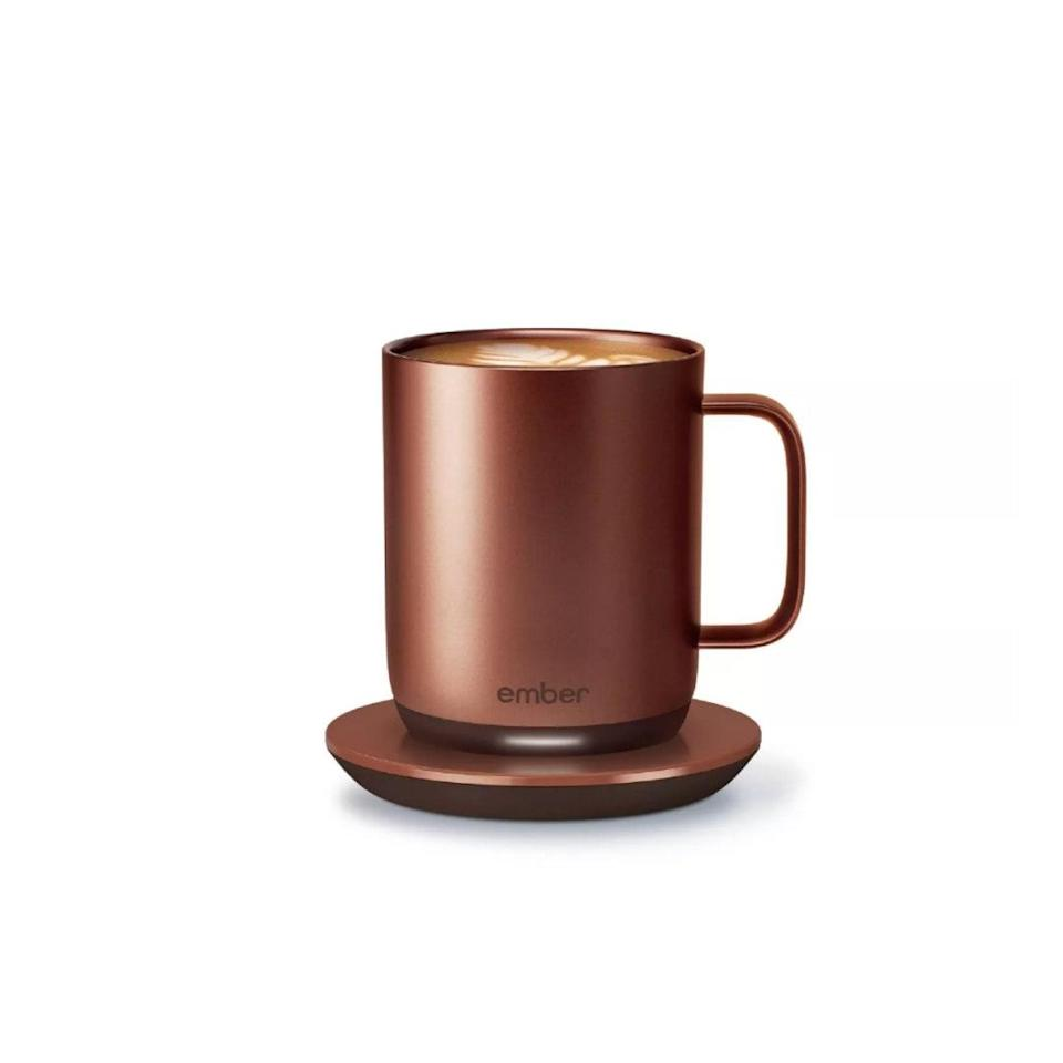 "Nothing kills a caffeine buzz faster than a mug that's accidentally iced your hot coffee on a chilly day. This one will keep it at precisely the right temperature—without a trip to the microwave every 20 minutes. $130, Target. <a href=""https://www.target.com/p/ember-mug-178-temperature-control-smart-mug-10oz-copper/-/A-79910209"" rel=""nofollow noopener"" target=""_blank"" data-ylk=""slk:Get it now!"" class=""link rapid-noclick-resp"">Get it now!</a>"