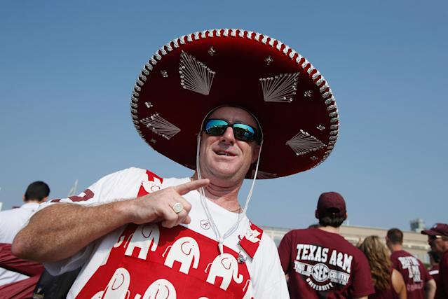 COLLEGE STATION, TX - SEPTEMBER 14: An Alabama fan poses near the stadium before the start of the game between the Alabama Crimson Tide and Texas A&M Aggies at Kyle Field on September 14, 2013 in College Station, Texas. (Photo by Scott Halleran/Getty Images)