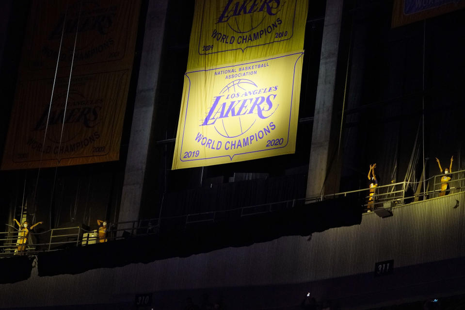 Members of the Laker Girls dance after the Los Angeles Lakers unveiled their 2019-2020 World Championship banner prior to an NBA basketball game against the Houston Rockets Wednesday, May 12, 2021, in Los Angeles. (AP Photo/Mark J. Terrill)