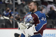 Colorado Avalanche goaltender Philipp Grubauer heads back to the net during a timeout in the first period of Game 1 of an NHL hockey Stanley Cup first-round playoff series against the St. Louis Blues, Monday, May 17, 2021, in Denver. (AP Photo/David Zalubowski)