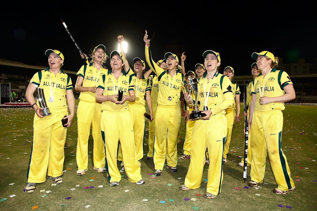 MUMBAI, INDIA - FEBRUARY 17:  Victorious players of Australia begin celebrating after taking the final wicket after defeating the West Indies the final between Australia and West Indies of the Women's World Cup India 2013 played at the Cricket Club of India ground on February 17, 2013 in Mumbai, India. (Photo by Graham Crouch/ICC via Getty Images)