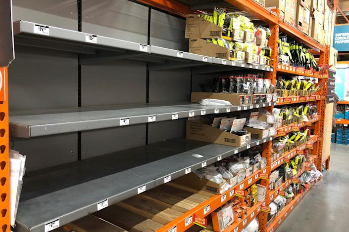 Shelves that previously contained masks and respirators are exposed at the Seattle Home Depot store, Tuesday, March 3, 2020. Besides the lack of hand sanitizer, hospitals are more concerned about the lack of face masks that people picked up. despite requests from health officials. (AP Photo / Ted S. Warren)