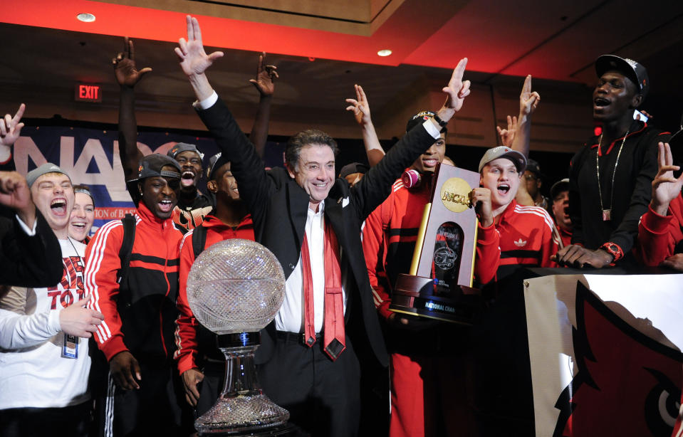 FILE - Louisville coach Rick Pitino and this team celebrate at the trophy ceremony after winning the NCAA Final Four tournament college basketball championship game against Michigan in Atlanta, in this Monday, April 8, 2013, file photo. Rick Pitino survived sex scandals and FBI investigations , won national championships , and when his coaching options seemingly dried up , he left for Greece. Somehow , the winding road of his career took him to Iona - and back in the NCAA Tournament. The last stop - he swears it's true - of his career. (AP Photo/John Amis, File)