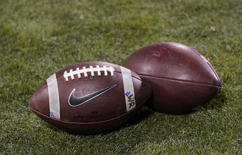 Nike logo dorns a football in the second half of an NCAA college football game Saturday, Nov. 28, 2020, in Boulder, Colo. Colorado won 20-10. (AP Photo/David Zalubowski)