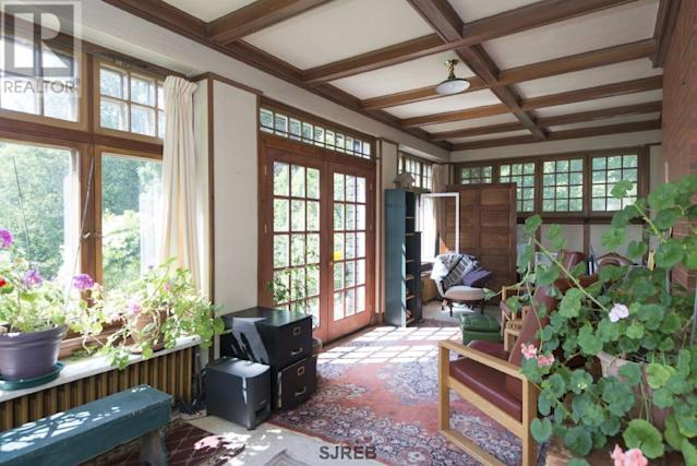 <p><span>3105 Rothesay Rd., Rothesay, N.B.</span><br> Relax on either the east or west sun porches (depending on the time of day, of course) in this Tudor Revival home.<br> (Photo: Zoocasa) </p>