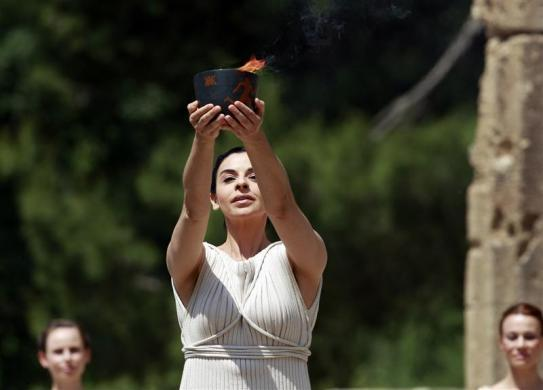 Greek actress Ino Menegaki, playing the role of High Priestess, holds up the cauldron with the Olympic flame during the torch lighting ceremony of the London 2012 Olympic Games at the site of ancient Olympia in Greece May 10, 2012.