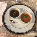<p>Soup Duo - concommé olga with sliced scallops, cream of barley</p>