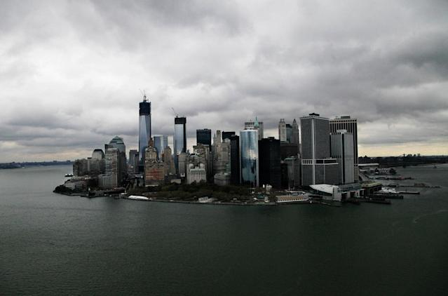 <p>This aerial photo of Wednesday, Oct. 31, 2012, shows the New York skyline and harbor. The vast destruction wreaked by the storm surge in New York could have been prevented with a sea barrier of the type that protects major cities in Europe, some scientists and engineers say. The multibillion-dollar price tag of such a project has been a hindrance, but may appear more palatable after the damage from Superstorm Sandy has been tallied. (AP Photo/Mark Lennihan) </p>