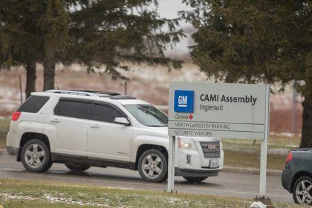 Workers leave the General Motors CAMI car assembly plant where the GMC Terrain and Chevrolet Equinox are built in Ingersoll