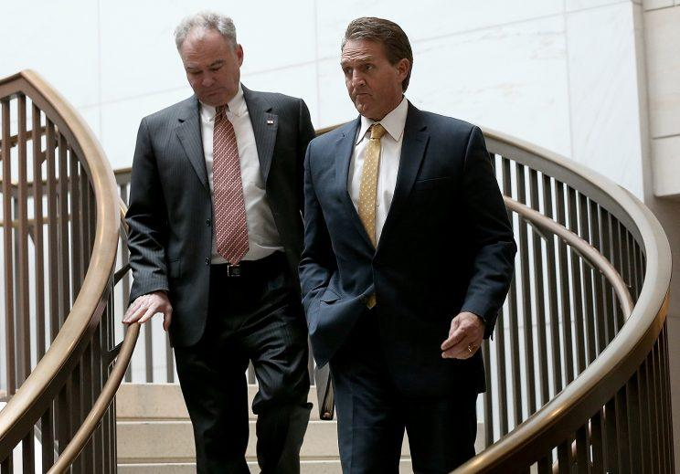 Sens. Jeff Flake, R-Ariz., right, and Tim Kaine, Va., walk to a closed briefing. (Photo: Win McNamee/Getty Images)