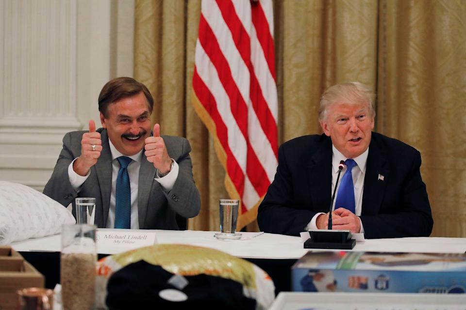 Michael Lindell ,CEO of My Pillow reacts as U.S. President Donald Trump attends a Made in America roundtable meeting in the East Room of the White House in Washington, U.S. July 19, 2017. REUTERS/Carlos Barria