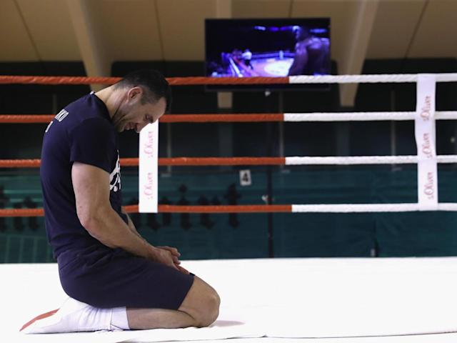 Joshua's knockouts are played on a loop on TVs around the training base (Getty)