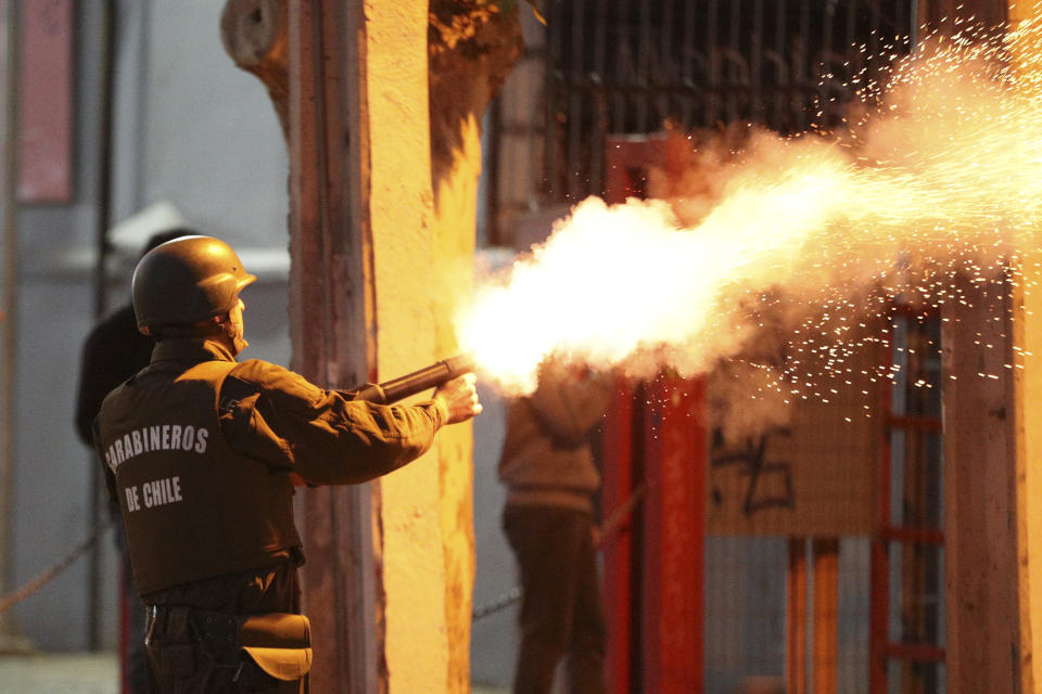 Police fire tear gas at protesters violating a curfew in downtown Santiago, Chile, Sunday, Oct. 20, 2019. Protests in the country have spilled over into a new day, even after President Sebastian Pinera cancelled the subway fare hike that prompted massive and violent demonstrations. (Photo: Esteban Felix/AP)