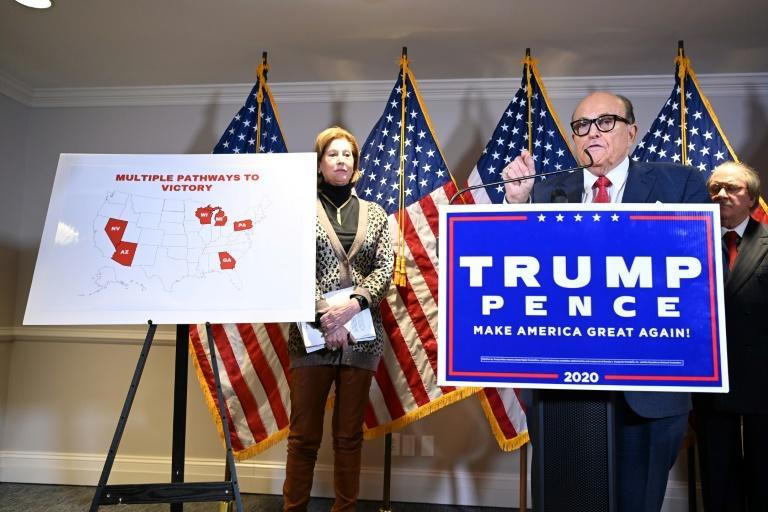 Sidney Powell, pictured here behind and to the left of Trump's personal lawyer Rudy Giuliani at a November 19 press conference, alleged baseless conspiracy theories related to the presidential election