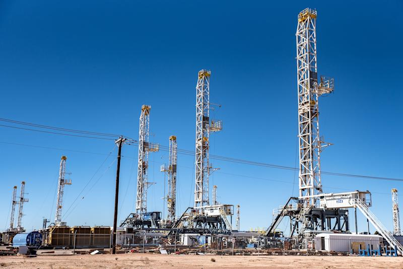 Oil rigs in the Permian Basin area of Odessa, Texas. Exxon Mobil plans to double its production in the Permian Basin to 1 million barrels per day over the next five years. (Photo: Sergio Flores/Bloomberg via Getty Images)