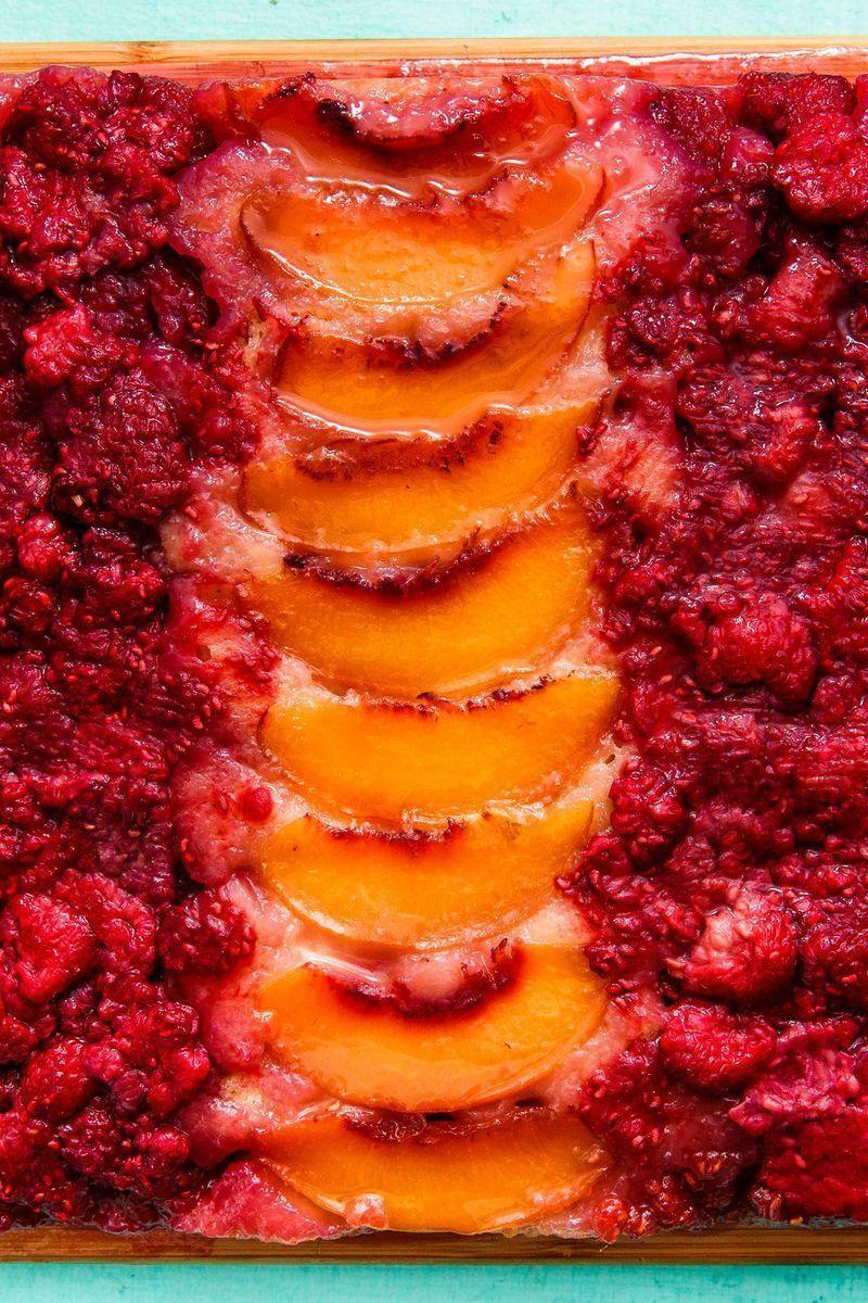 """<p>This cake is DANGEROUSLY good. Not to mention, it's a work of art! </p><p>Get the <a href=""""https://www.delish.com/uk/cooking/recipes/a32943108/raspberry-peach-upside-down-cake-recipe/"""" rel=""""nofollow noopener"""" target=""""_blank"""" data-ylk=""""slk:Raspberry Peach Upside Down Cake"""" class=""""link rapid-noclick-resp"""">Raspberry Peach Upside Down Cake</a> recipe.</p>"""