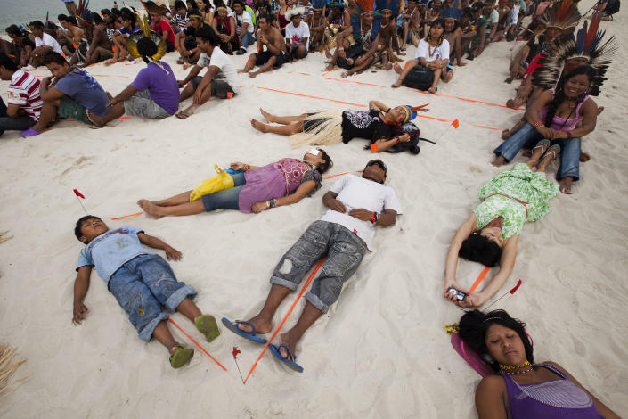 People participate in a human banner on Flamengo beach, organized by Amazon Watch, on the sidelines of the Rio+20, or UN Conference on Sustainable Development in Rio de Janeiro, Brazil, Tuesday, June 19, 2012. The activists are calling attention to threats posed to rivers, forests and livelihoods by large hydroelectric dams, like the Belo Monte hydroelectric plant being constructed in Brazil's Amazon. (AP Photo/Victor R. Caivano)