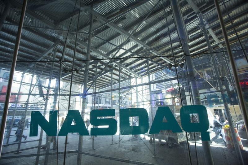 Scaffolding is seen outside the NASDAQ MarketSite in Times Square in New York April 17, 2014. REUTERS/Andrew Kelly/Files