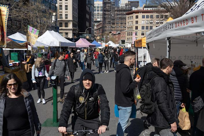 Shoppers at the Union Square Greenmarket in Manhattan, March 21, 2020. (James Sprankle/The New York Times)