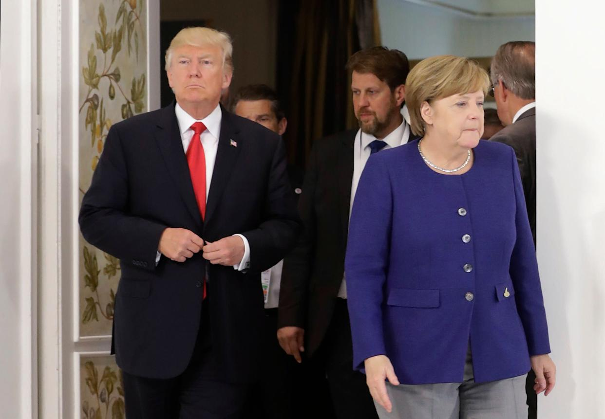 German Chancellor Angela Merkel and U.S. President Donald Trump arrive for a bilateral meeting on the eve of the G-20 summit in Hamburg, Germany, on July 6, 2017.