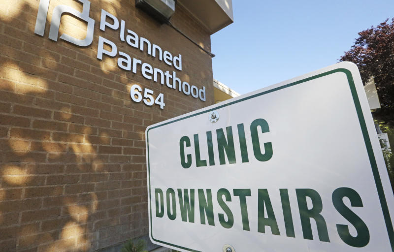 FILE - In this Aug. 21, 2019, file photo, a sign is displayed at Planned Parenthood of Utah in Salt Lake City. An appeals court is considering whether to block a Trump administration rule that bans taxpayer-funded health clinics from referring patients for an abortion, a rule that has already prompted many providers, including Planned Parenthood, to leave a longstanding federal family planning program. Eleven judges from the 9th U.S. Circuit Court of Appeals in San Francisco heard arguments Monday, Sept. 23, 2019, in challenges brought by 22 states as well as Planned Parenthood and other organizations. (AP Photo/Rick Bowmer, File)