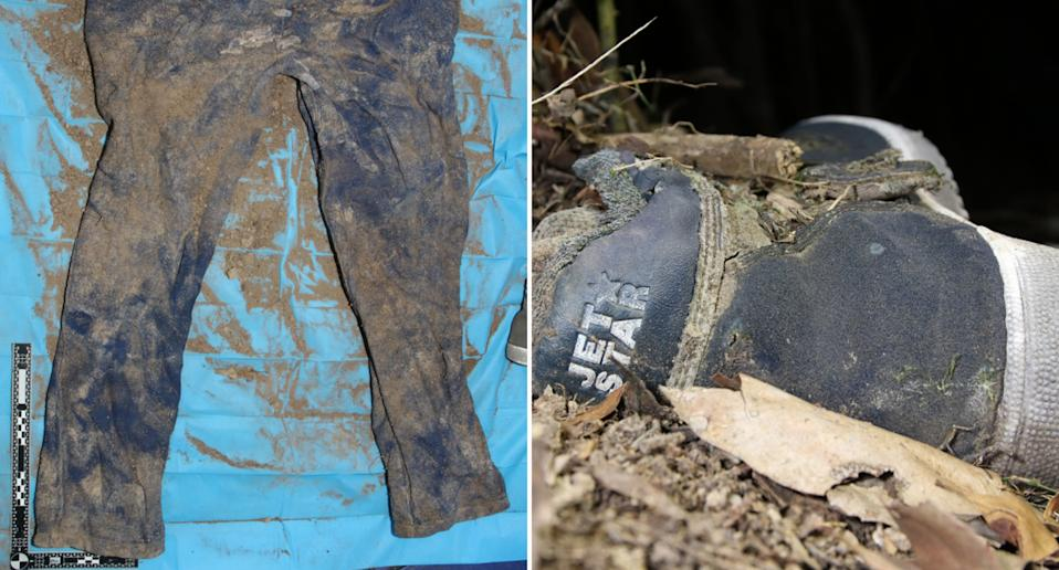 A shoe and blue pants covered in dirt found in bushland in Gympie.