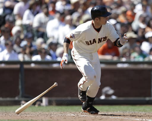 San Francisco Giants' Buster Posey swings for an RBI-single off Washington Nationals' Drew Storen in the eighth inning of a baseball game on Wednesday, May 22, 2013, in San Francisco. (AP Photo/Ben Margot)