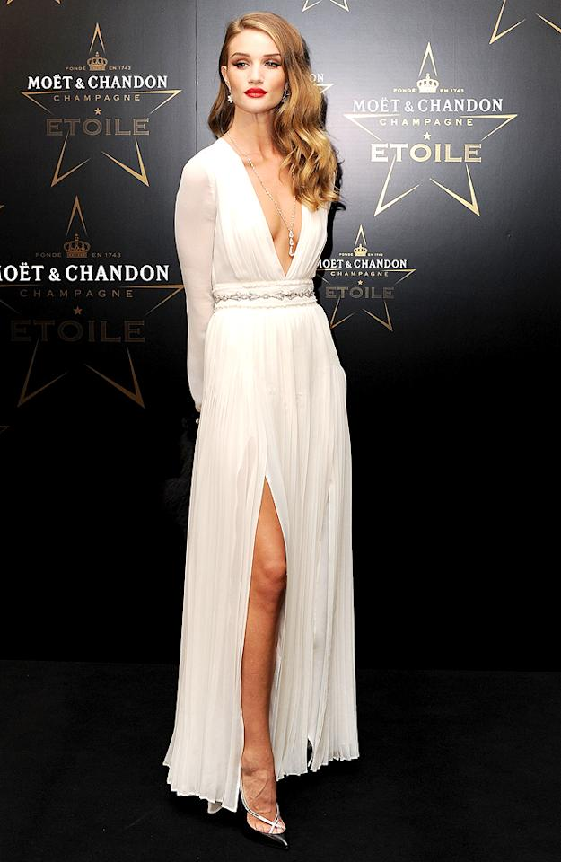 """Transformers: Dark of the Moon"" actress/model Rosie Huntington-Whitely wowed in a white Burberry creation featuring a plunging neckline and a thigh-high slit. (09/19/2011)"