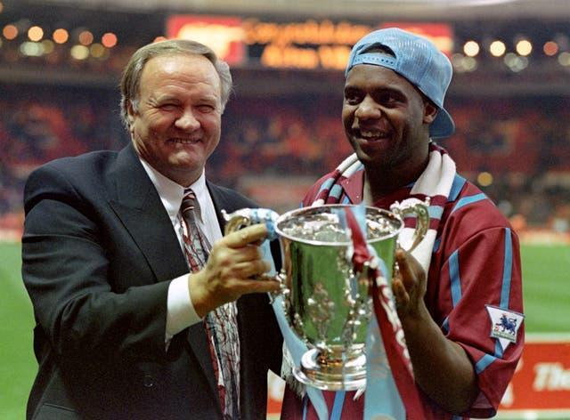 Former Aston Villa manager Ron Atkinson holds the League Cup with Dalian Atkinson