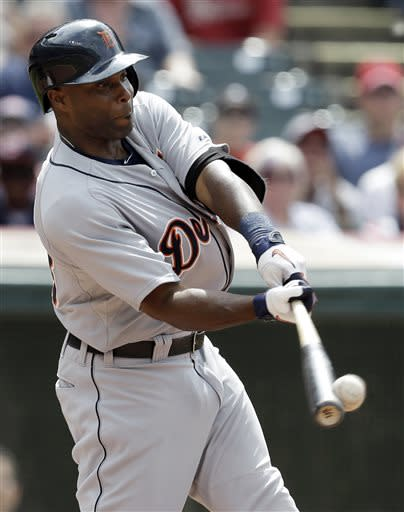 Detroit Tigers' Torii Hunter hits a three-run home run off Cleveland Indians relief pitcher Vinnie Pestano in the eighth inning of a baseball game on Sunday, July 7, 2013, in Cleveland. Tigers' Andy Dirks and Ramon Santiago also scored. (AP Photo/Tony Dejak)