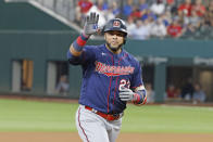 Minnesota Twins' Nelson Cruz (23) waves to family in the stands as he celebrates his two-run home run against the Texas Rangers during the fourth inning of a baseball game Saturday, June 19, 2021, in Arlington, Texas. (AP Photo/Michael Ainsworth)