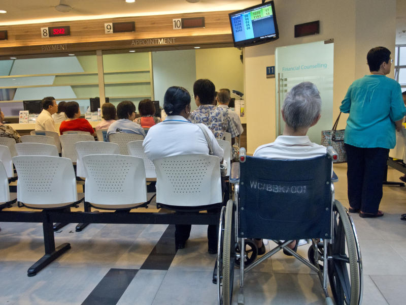 Patients waiting to be attended by doctors at a polyclinic medical centre in Singapore. (Photo by: Majority World/Universal Images Group via Getty Images)
