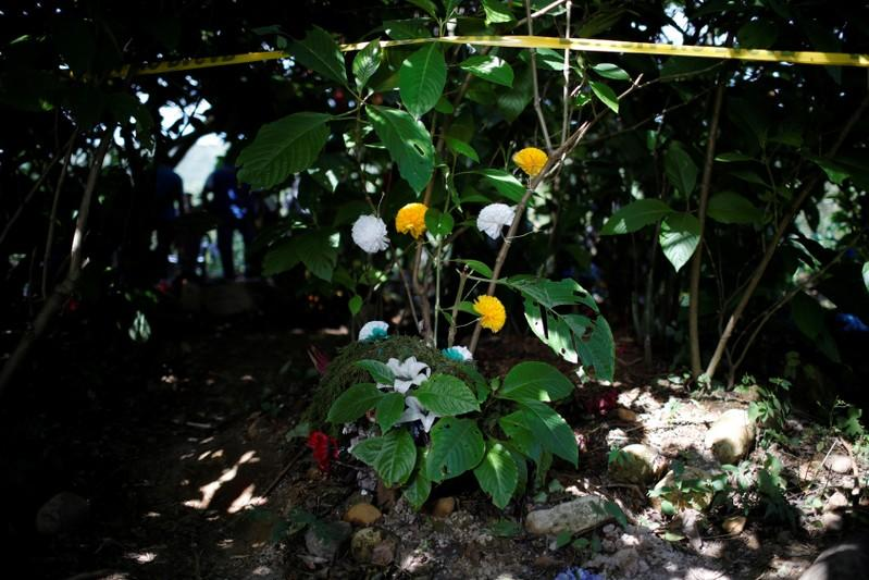 Wreaths and flowers are seen at an exhumation site in the village of Yancolo as a forensic team searches for human remains of the El Mozote massacre in the town of Cacaopera