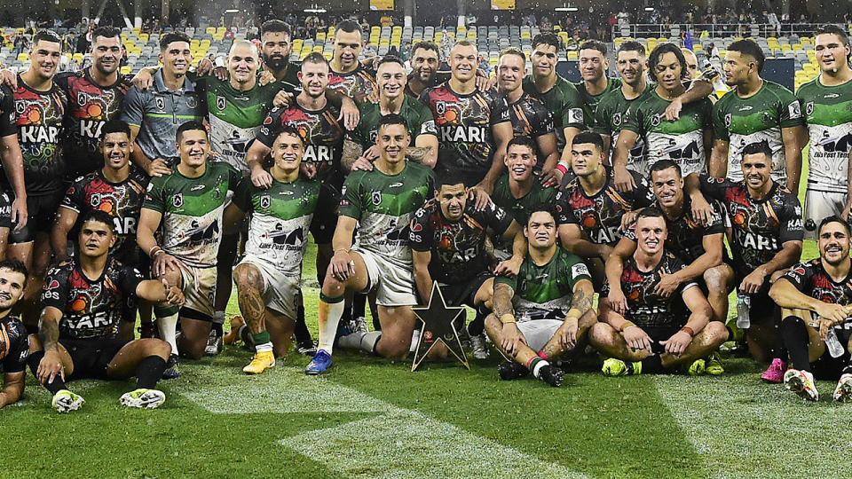 The Indigenous and Maori All Stars players, pictured here with the trophy.