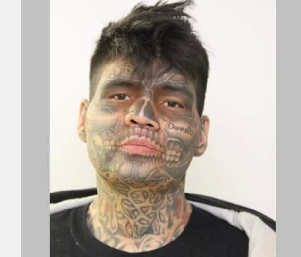 Clint Carifelle, 30, is a dangerous offender who has allegedly removed his monitoring ankle bracelet.  (Supplied by Edmonton Police Service  - image credit)